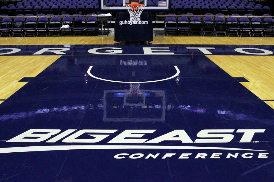 FILE - In this Dec. 15, 2012, file photo, a Big East Conference logo is displayed on the court after Georgetown played Western Carolina in an NCAA college basketball game at the Verizon Center in Washington.  Big East football schools will get almost all of a $110 million pot in a deal that will allow seven departing basketball schools to keep the name Big East and start playing in their own conference next season, a person familiar with the negotiations says. The basketball schools, which include Georgetown, St. John's, Villanova, Seton Hall, Providence, Marquette and DePaul, will receive $10 million, keep the conference name and the right to play their conference tournament at Madison Square Garden. (AP Photo/Jacquelyn Martin, File) Photo: Jacquelyn Martin