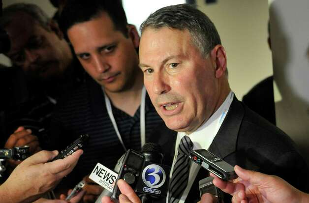 FILE - In this Aug. 30, 2012, file photo, Big East commissioner Mike Aresco answers questions from the media before an NCAA college football game between Connecticut and Massachusetts at Rentschler Field in East Hartford, Conn. Big East football schools will get almost all of a $110 million pot in a deal that will allow seven departing basketball schools to keep the name Big East and start playing in their own conference next season, a person familiar with the negotiations says. They will receive approximately $100 million under the agreement, most of which will go to holdover members Connecticut, South Florida and Cincinnati.  (AP Photo/Jessica Hill, File) Photo: Jessica Hill