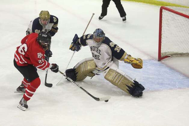 Mike Ross Connecticut Post freelance -Fairfield Prep's #26 Matt McKinney makes a goal on Notre Dame Fairfield's goalie #35  Stone Denbok duirng second period action on Thursday evening match-up. Photo: Mike Ross / @www.mikerossphoto.com