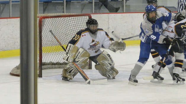 Stone Denbok prepares to stop a shot as a member of the Burlington Eagles Bantam AAA Team in 2010. Photo: Contributed Photo