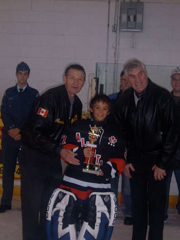 Stone Denbok, middle, poses with Walter Gretzky, left, in 2007. Denbok played for Gretzky-- father of NHL Hall of Famer Wayne-- on an all-star team. Photo: Contributed Photo