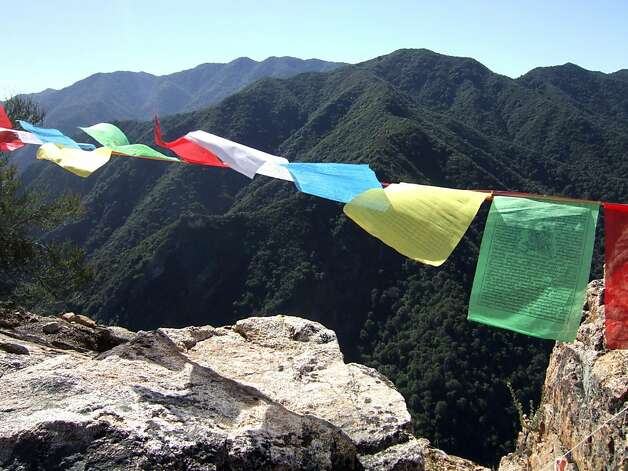 Tibetan flags flap in the wind over Flag Rock. Photo: Shundo David Haye