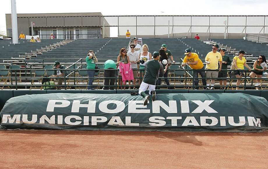 A's pitcher Pat Neshek signs autographs for early arrivals at Phoenix Municipal Stadium on Tuesday. Photo: Michael Macor, The Chronicle