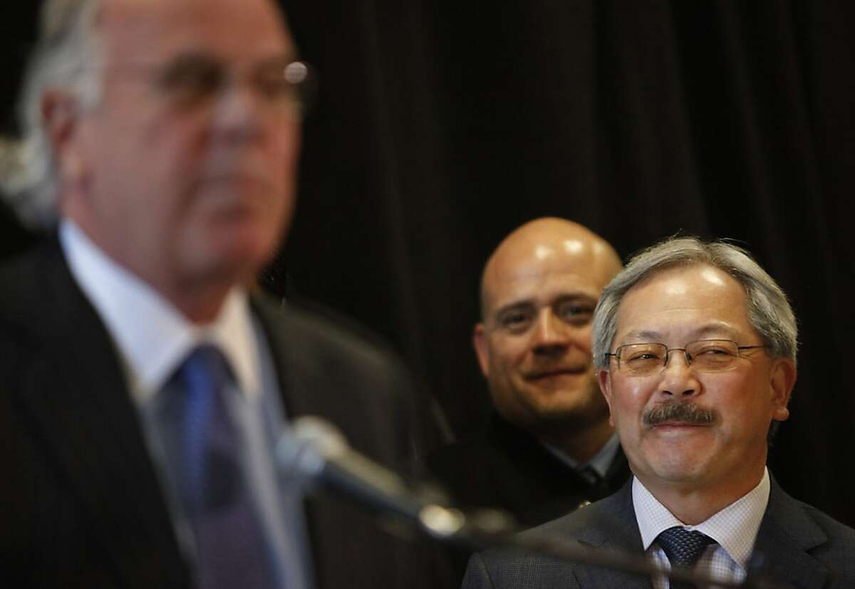 Mayor Ed Lee (right) smiles as he listens to Lou Giraudo (right), owner of San Francisco's Boudin Bakery, speak during a press conference at St. Lukes Hospital announcing plans to rebuild California Pacific Medical Center's healthcare facilities on Tuesday, March 5, 2013 in San Francisco, Calif.