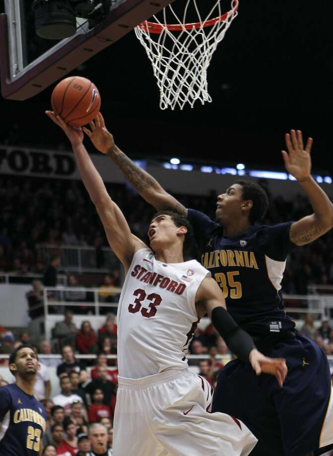 Cal's Richard Solomon (35) denies Stanford's Dwight Powell of a basket in the second half of Stanford's 69-59 win over Cal at Maples Pavilion in Stanford, Calif. on Saturday, Jan. 19, 2013. Photo: Paul Chinn, The Chronicle