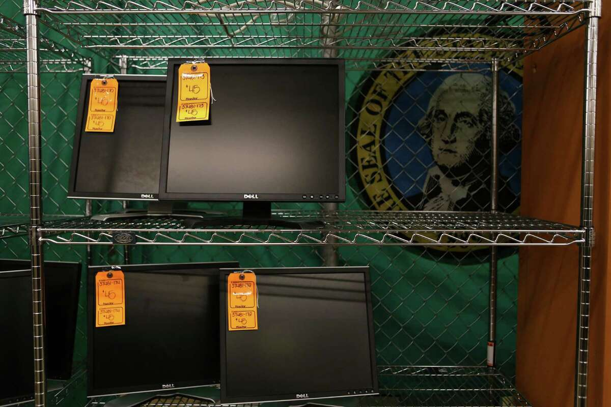 Computer monitors are shown for $45 at the University of Washington Surplus Store on Tuesday, March 5, 2013. The store sells items no longer being used by the university, often at rock bottom prices.