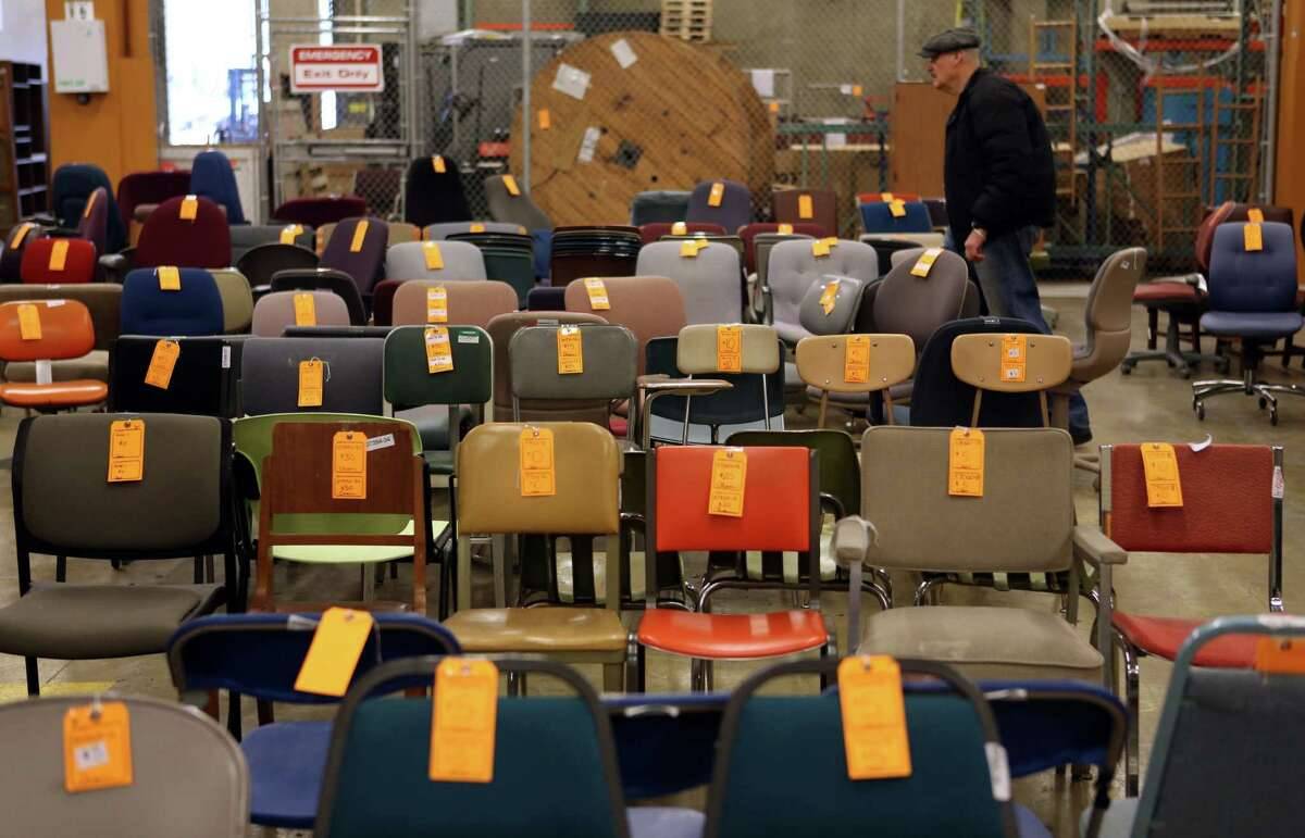An assortment of chairs are shown at the University of Washington Surplus Store on Tuesday, March 5, 2013. The store sells items no longer being used by the university, often at rock bottom prices.