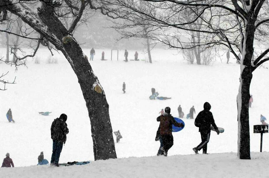 Sledders and snowboarders start amongst the oak trees at the top of the hills at Randall Oaks Park in the Chicago suburb of West Dundee, Ill. during a snow storm on Tuesday, March 5, 2013. Photo: John Starks, Associated Press / Daily Herald