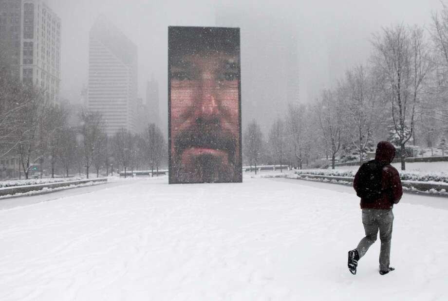 A man walks around the Millennium Park as a snow storm passes through the region Tuesday, March 5, 2013, in Chicago. Chicago was hit Tuesday by a storm expected to dump as much as 10 inches of snow in the area before the end of the day, the most since the 2011 blizzard and its more than 20 inches of snow. Photo: Kiichiro Sato, Associated Press / AP