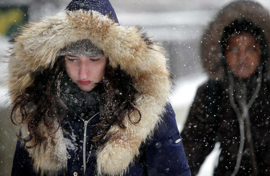 Bundled against the cold, wet conditions, University of Wisconsin-Madison student Natalie Weill makes her way through the campus' Library Mall as a steady snowstorm moves throughout the Madison, Wis. area Tuesday, March 5, 2013. Photo: John Hart, Associated Press / Wisconsin State Journal