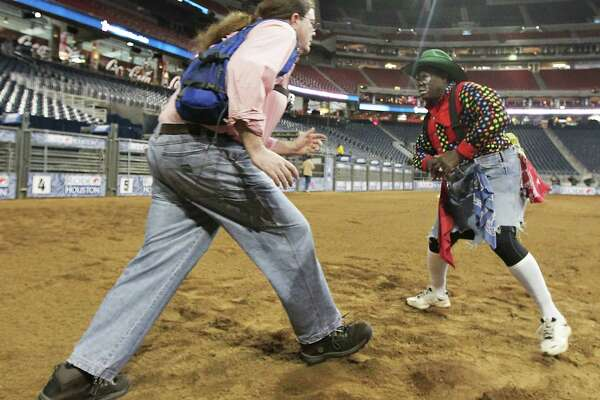 Houston Chronicle reporter Dug Begley, left, and RodeoHouston bullfighter Leon Coffee, right, work on bullfighting techniques at Reliant Stadium Friday, March 1, 2013, in Houston.