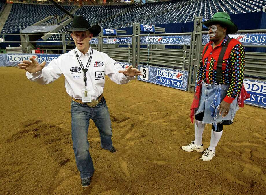 RodeoHouston bullfighters Cory Wall, left, and Leon Coffee, right, discuss bullfighting techniques with Houston Chronicle reporter Dug Begley at Reliant Stadium Friday, March 1, 2013, in Houston. Photo: James Nielsen, Houston Chronicle / © 2013  Houston Chronicle