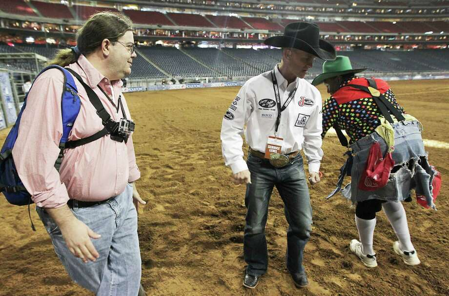 Houston Chronicle reporter Dug Begley, left, and RodeoHouston bullfighters Cory Wall, center, and Leon Coffee, right, discuss bullfighting techniques at Reliant Stadium Friday, March 1, 2013, in Houston. Photo: James Nielsen, Houston Chronicle / © 2013  Houston Chronicle