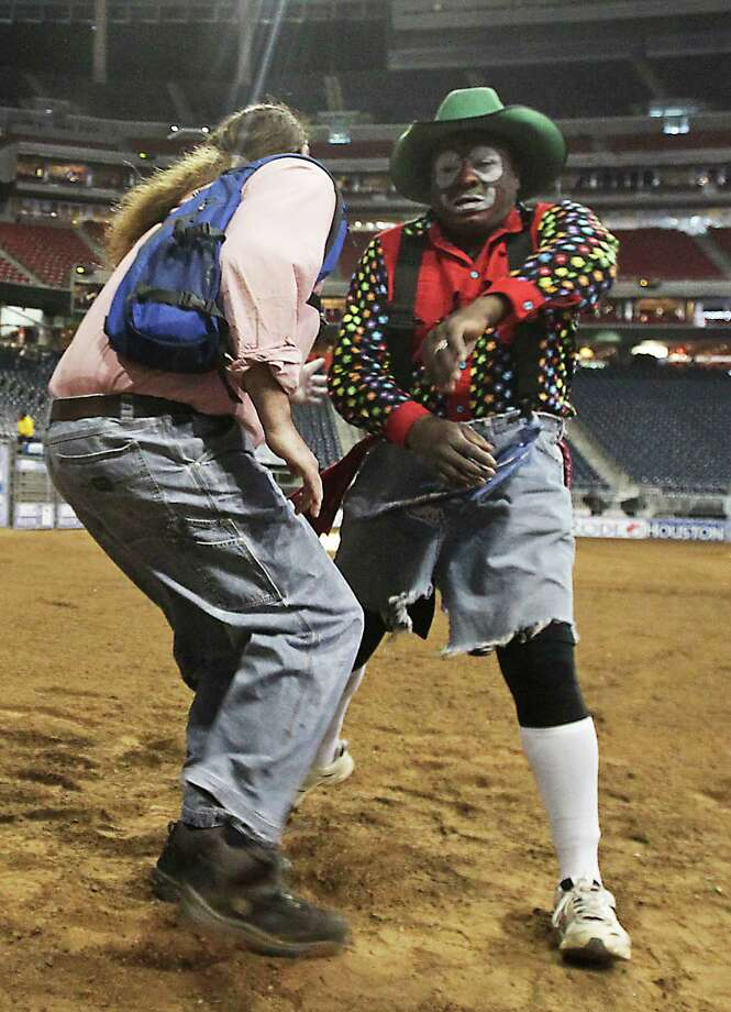 Houston Chronicle reporter Dug Begley, left, and RodeoHouston bullfighters Leon Coffee, right, work on bullfighting techniques at Reliant Stadium Friday, March 1, 2013, in Houston. Photo: James Nielsen, Houston Chronicle / © 2013  Houston Chronicle