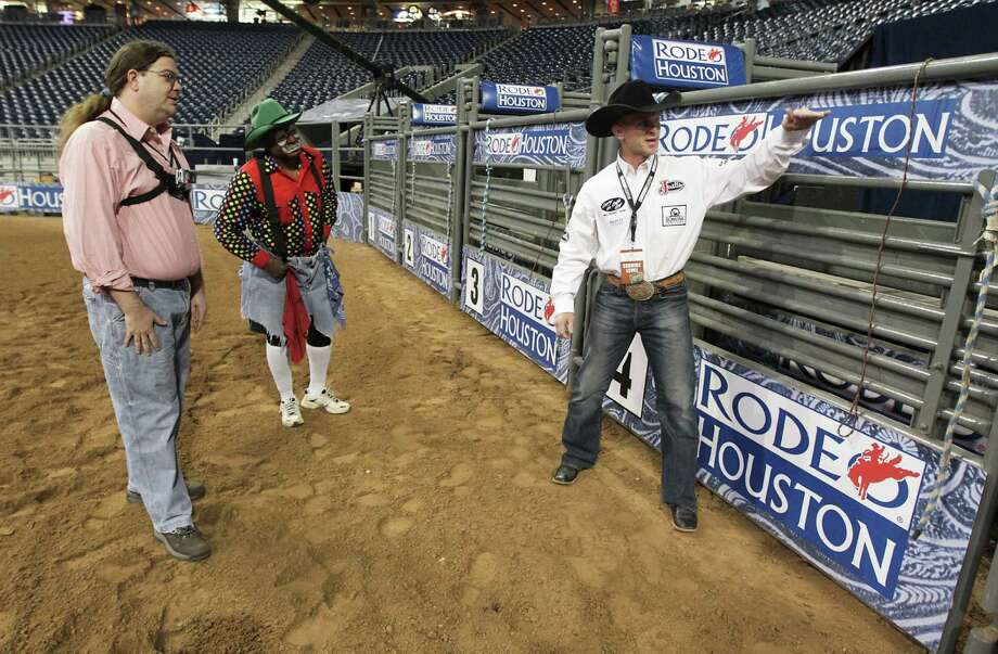 Houston Chronicle reporter Dug Begley, left, and RodeoHouston bullfighters Leon Coffee, center, and Cory Wall, right, discuss bullfighting techniques at Reliant Stadium Friday, March 1, 2013, in Houston. Photo: James Nielsen, Houston Chronicle / © 2013  Houston Chronicle