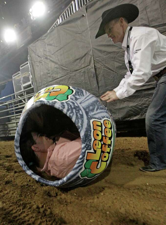 RodeoHouston bullfighter Cory Wall, right, discusses bullfighting techniques as he rolls a bullfighting barrel with Houston Chronicle reporter Dug Begley inside at Reliant Stadium Friday, March 1, 2013, in Houston. Photo: James Nielsen, Houston Chronicle / © 2013  Houston Chronicle