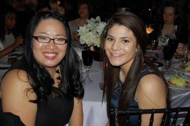 "Angela Zhou of Stamford, left, and Melissa Serrano of Norwalk, are two people who benefited from their experience with Horizons at New Canaan Country School. ""I can't imagine what I'd be doing with my summers if I didn't have Horizons,"" said Zhou, who came back to teach after attending since kindergarten. Photo by Jarret Liotta Photo: Contributed Photo"