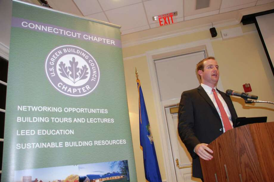 Alex Kragie, deputy chief of staff for the Connecticut Department of Energy & Environmental Protection, addressed the crowd at the Breakthroughs in Energy Legislation forum at the Lapham Community Center Thursday, Feb. 27. Photo by Jarret Liotta Photo: Contributed Photo