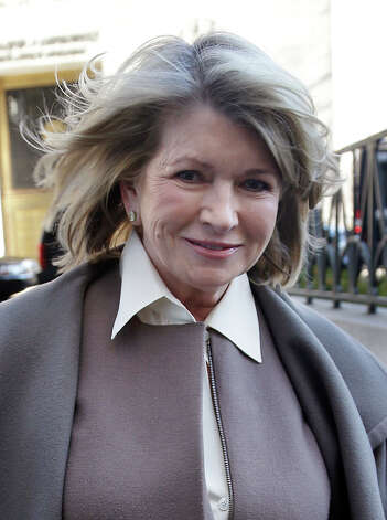 Martha Stewart arrives to court in New York, Tuesday, March 5, 2013. Macy's Inc. is suing the media and merchandising company Stewart founded for breaching an exclusive contract when she signed a deal with J.C. Penney in December 2011 to open shops at most of its stores this spring. Photo: Seth Wenig, Associated Press / Associated Press