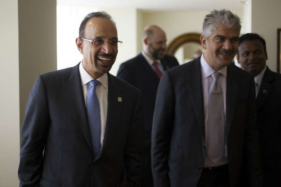 Khalid Al-Falih (left), president and CEO of Saudi Aramco, leaves an interview at the Four Seasons Hotel during IHS CERAWeek on Tuesday.