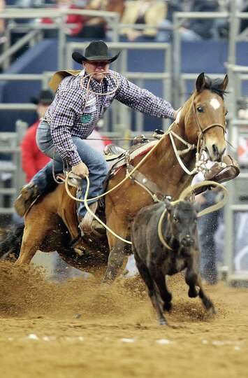 Justin Mass competes in Tie-Down Roping during the BP Super Series III Championship at Reliant Stadi