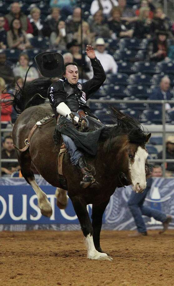 Jessy Davis competes in Bareback Riding during the BP Super Series III Championship at Reliant Stadium on Tuesday, March 5, 2013, in Houston. Photo: Mayra Beltran, Houston Chronicle / © 2013 Houston Chronicle