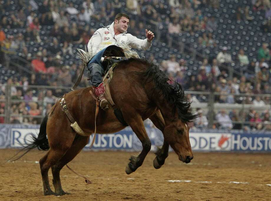 Kaycee Feild competes in Bareback Riding during the BP Super Series III Championship at Reliant Stadium on Tuesday, March 5, 2013, in Houston. Photo: Mayra Beltran, Houston Chronicle / © 2013 Houston Chronicle