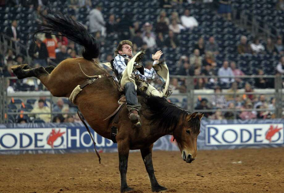 Joe Gunderson competes in Bareback Riding during the BP Super Series III Championship at Reliant Stadium on Tuesday, March 5, 2013, in Houston. Photo: Mayra Beltran, Houston Chronicle / © 2013 Houston Chronicle