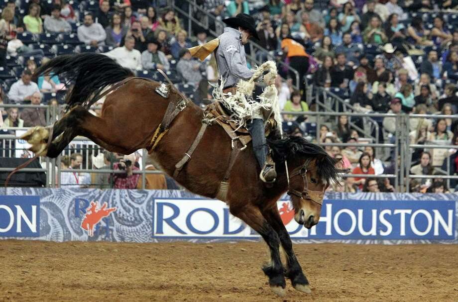 Sterling Crawley competes in Saddle Bronc Riding during the BP Super Series III Championship at Reliant Stadium on Tuesday, March 5, 2013, in Houston. Photo: Mayra Beltran, Houston Chronicle / © 2013 Houston Chronicle