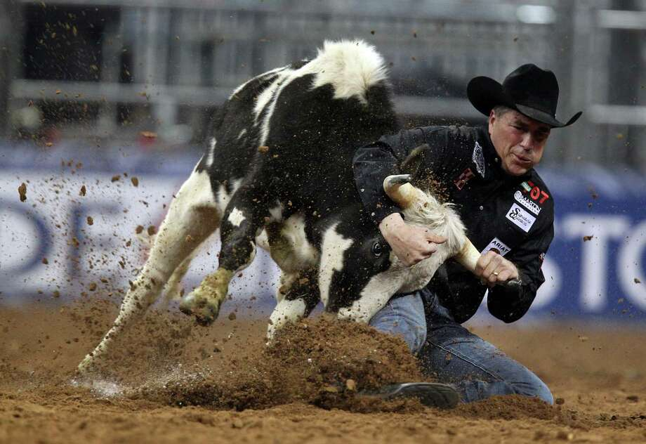 Todd Suhn competes in Steer Wrestling during the BP Super Series III Championship at Reliant Stadium on Tuesday, March 5, 2013, in Houston. Photo: Mayra Beltran, Houston Chronicle / © 2013 Houston Chronicle