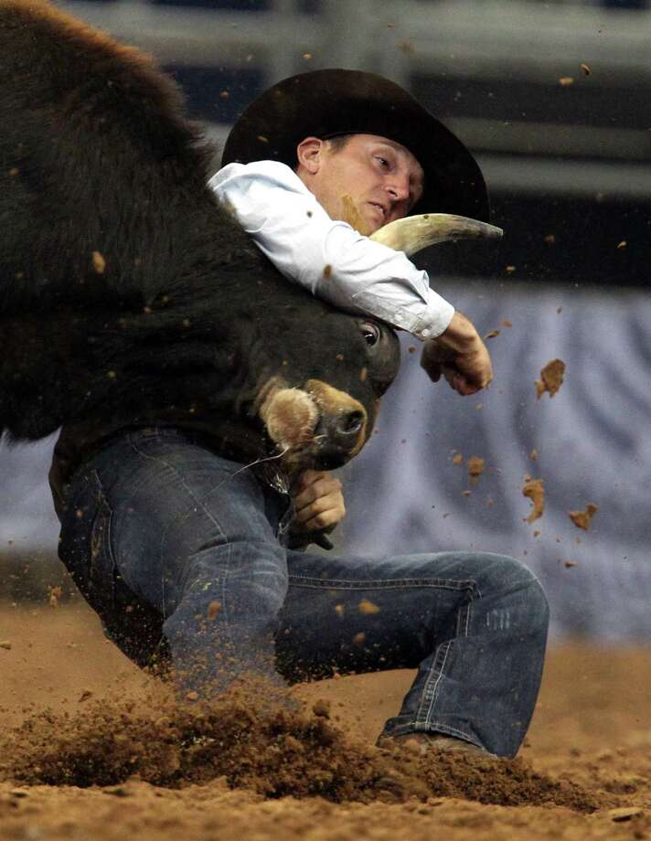 Sean Santucci competes in Steer Wrestling during the BP Super Series III Championship at Reliant Stadium on Tuesday, March 5, 2013, in Houston. Photo: Mayra Beltran, Houston Chronicle / © 2013 Houston Chronicle