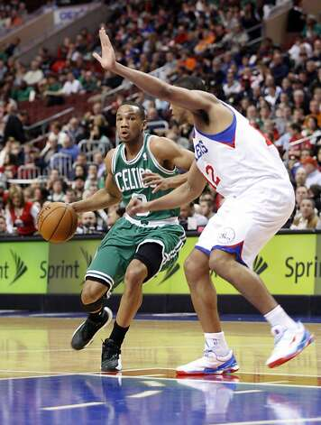 Boston's Avery Bradley drives on the 76ers' Evan Turner. Photo: H. Rumph Jr, Associated Press