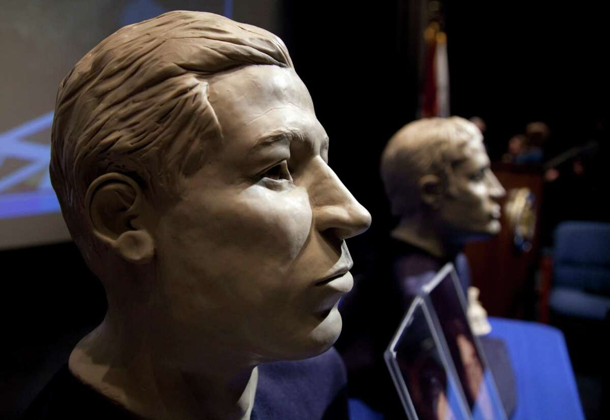 FILE - In this March 6, 2012 file photo, phases of facial reconstruction of the two sailors of the Civil War ironclad USS Monitor, older is at left, are on display in the auditorium of the United States Navy Memorial in Washington. The remains of the two unknown Union sailors recovered from the Civil War ironclad USS Monitor will be interred in Arlington National Cemetery on March 8. A century and a half after the USS Monitor sank, the interment of remains of two unknown sailors found in the Civil War ironclad?'s turret is bringing together nearly 100 people from Maine to California who have a distant familial tie to the 16 Union sailors who died when the ship went down. (AP Photo/Carolyn Kaster, File)