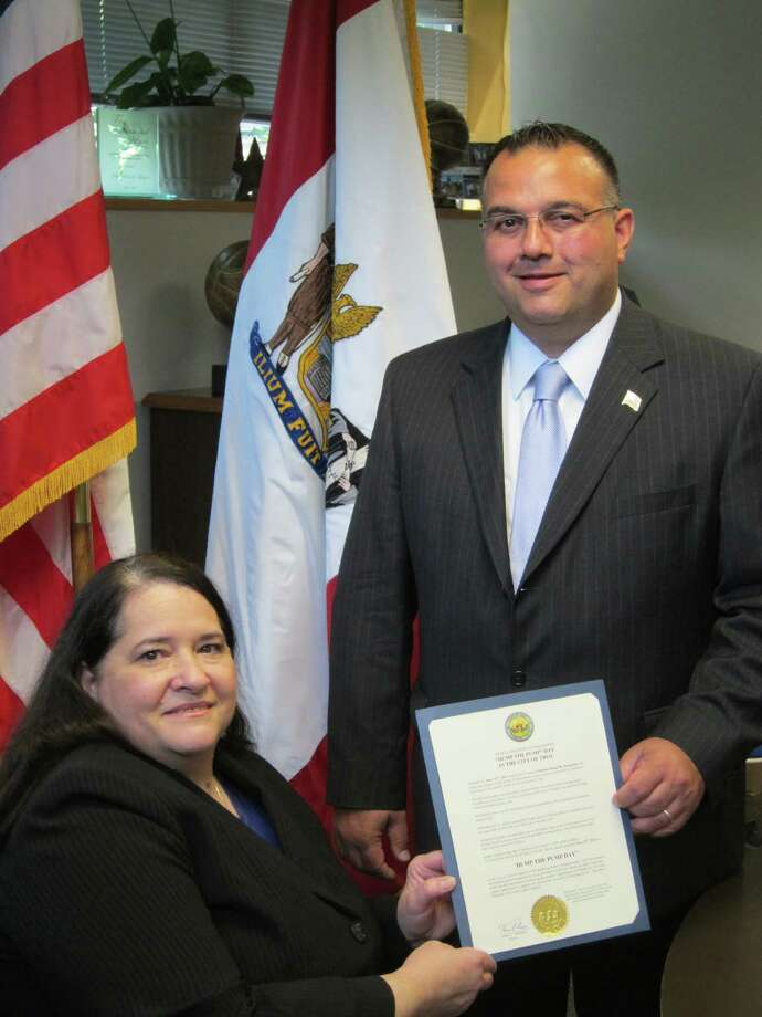 Denise Figueroa, CDTA board of directors chairwoman, left, is presented with a proclamation by Mayor Harry Tutunjian, right, which named June 16, 2011 ?Dump the Pump Day? in the City of Troy.  The effort supports the American Public Transportation Association (APTA) initiative promoting public transportation as a money-saving, ?green? alternative to private vehicle use.  (Courtesy City of Troy)