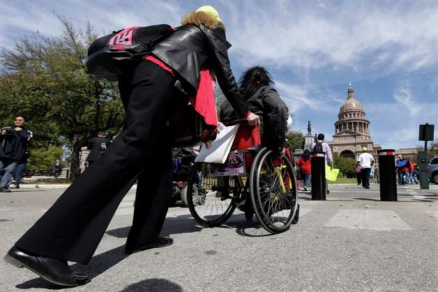 Protesters converge on the Texas Capitol on Tuesday, demanding that lawmakers expand Medicaid to include an additional 1.5 million poor people. Photo: Eric Gay, STF / AP