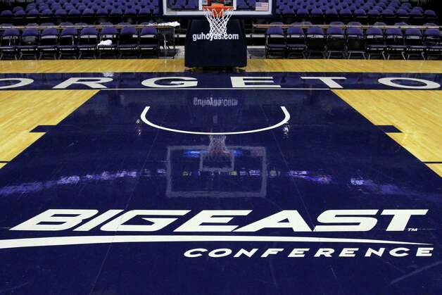 FILE - In this Dec. 15, 2012, file photo, a Big East Conference logo is displayed on the court after Georgetown played Western Carolina in an NCAA college basketball game at the Verizon Center in Washington.  Big East football schools will get almost all of a $110 million pot in a deal that will allow seven departing basketball schools to keep the name Big East and start playing in their own conference next season, a person familiar with the negotiations says. The basketball schools, which include Georgetown, St. John's, Villanova, Seton Hall, Providence, Marquette and DePaul, will receive $10 million, keep the conference name and the right to play their conference tournament at Madison Square Garden. Photo: Jacquelyn Martin