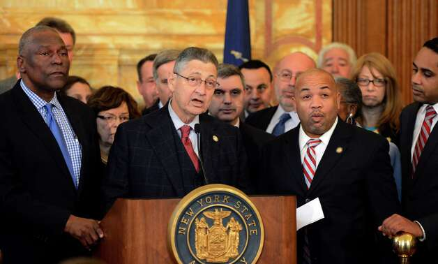 Assembly Speaker Shelly Silver, center talks about the pending vote on the minimum wage bill at the State Captiol March 5, 2013 in Albany, N.Y.   (Skip Dickstein/Times Union) Photo: SKIP DICKSTEIN / 10021423A