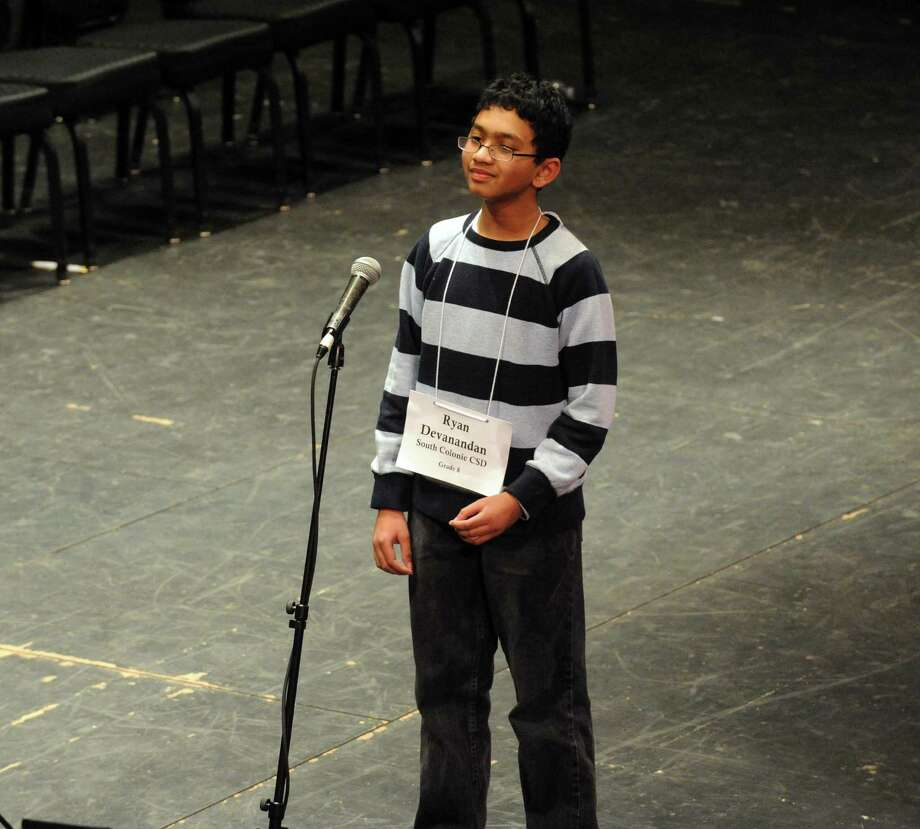 South Colonie eighth grade student Ryan Devanandan, right, wins the 2013 Capital Region Spelling Bee at Proctors Theatre on Tuesday March 5, 2013 in Schenectady, N.Y. (Michael P. Farrell/Times Union) Photo: Michael P. Farrell
