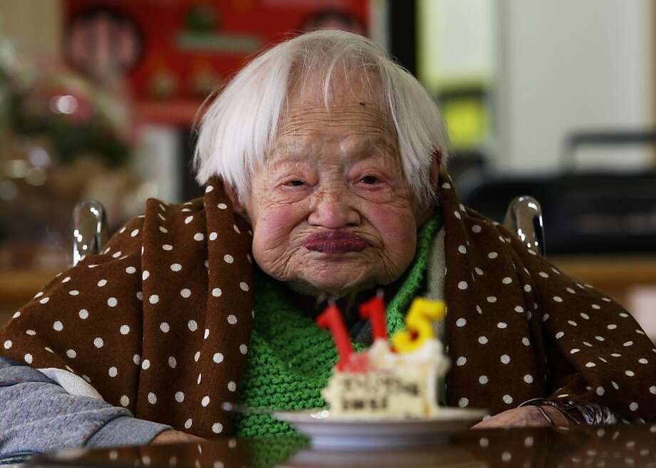 Misao Okawa, who is recognised by Guinness World Records as the world's oldest woman, receives a birthday cake during her 115th birthday celebrations at Kurenai Nursing Home on March 5, 2013 in Osaka, Japan. Misao Okawa, was born in Tenma, Osaka, on March 5, 1898. A descendent of Kimono merchants, she married in 1919 and had three children, of which a daughter and a son are still alive, and four grandchildren and six great-grandchildren.  Photo: Buddhika Weerasinghe, Getty Images