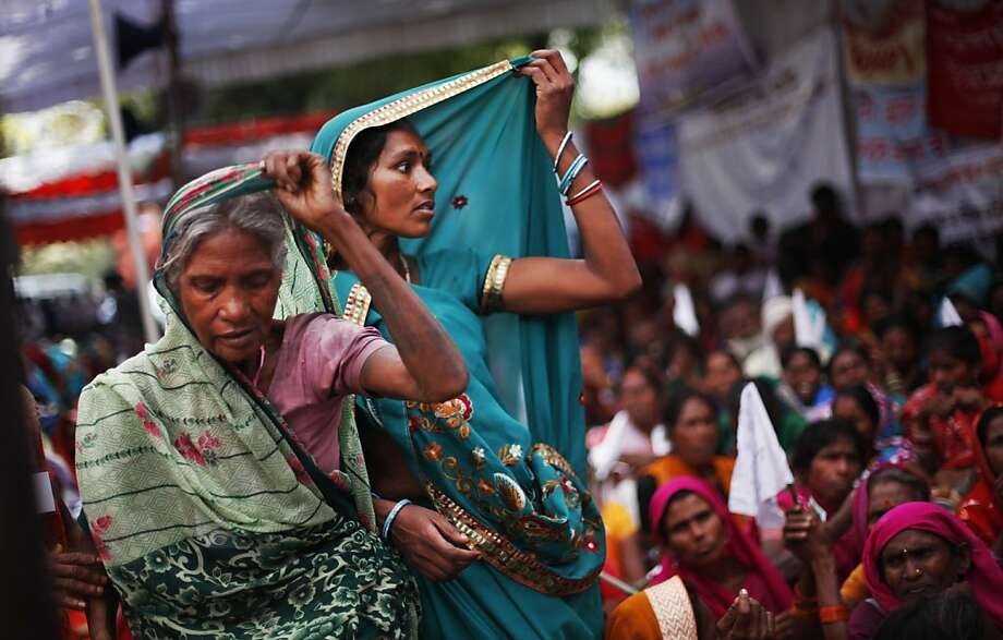 Indian village women adjust their saris, listening to a speaker, unseen, as the economically backward protesters stage a rally demanding pension for elderly poor citizens in New Delhi, India, Tuesday, March 5, 2013.  Photo: Altaf Qadri, Associated Press