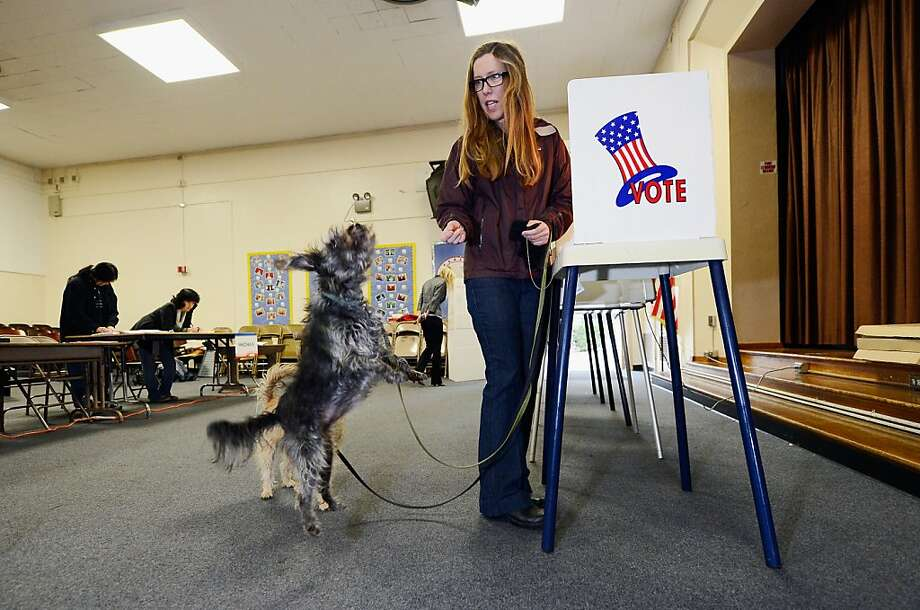 Anna Donlin gives a treat to her dogs Pearl (L) and Walnut after she cast her ballot at Allesandro Elemantary School on March 5, 2013 in Boyle Heights area Los Angeles, California. Turnout is expected to be very low among the city's 1.8 million people, making a run off at the end of May all but certain. Los Angeles City Councilman Eric Garcetti and  Controller Wendy Greuel are locked in a close tie for the lead in the Los Angeles mayoral primary. The top two vote getters will face each other in a run-off in late May.  Photo: Kevork Djansezian, Getty Images