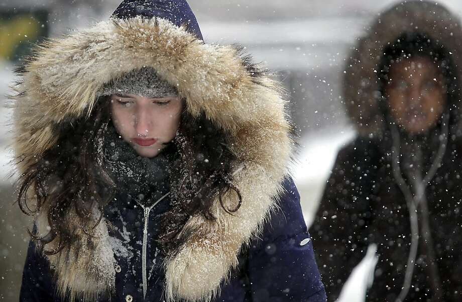 Bundled against the cold, wet conditions, University of Wisconsin-Madison student Natalie Weill makes her way through the campus' Library Mall as a steady snowstorm moves throughout the Madison, Wis. area Tuesday, March 5, 2013.  Photo: John Hart, Associated Press
