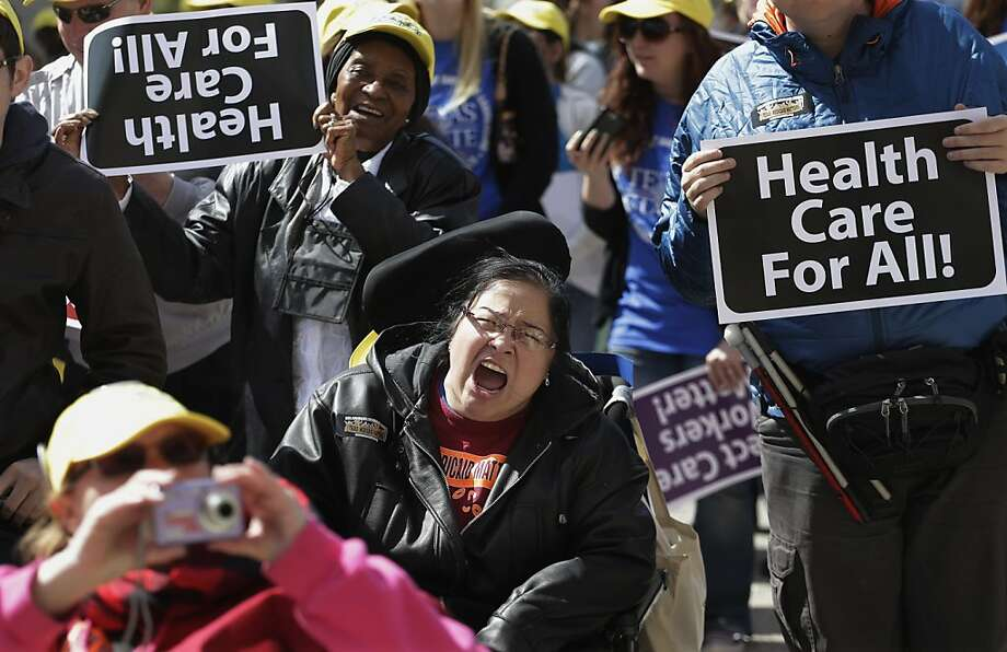 Protesters march on the Texas capitol, Tuesday, March 5, 2013, in Austin, Texas. Protesters demanded that lawmakers expand Medicaid to include an additional 1.5 million poor people.  Photo: Eric Gay, Associated Press