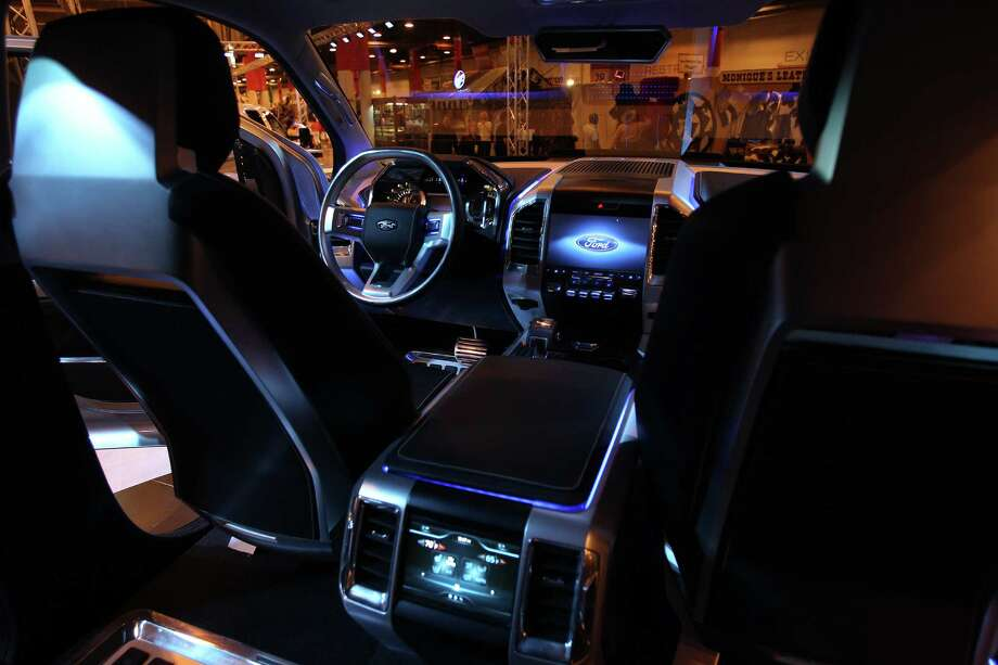 The interior of the Atlas, with its thin seats and sharply angled features, is far different from a traditional F-150. Photo: Mayra Beltran, Staff / © 2013 Houston Chronicle