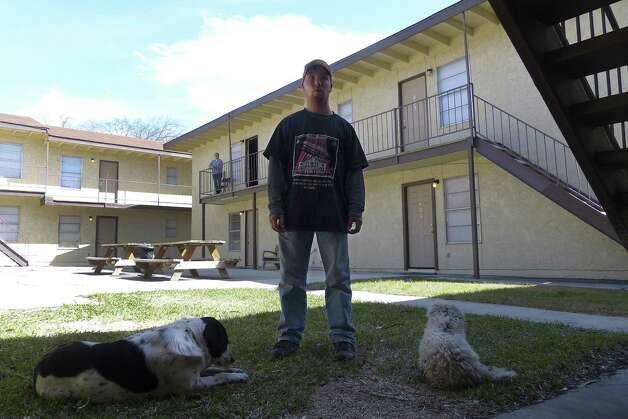 Thomas Allen, 21, stands outside the Delmar Street apartment complex. It was his cellphone that Eduardo Gutierrez, 19, borrowed to call police and say he planned to shoot a neighbor. Photo: Billy Calzada / San Antonio Express-News