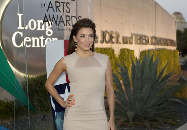 "Eva Longoria arrives at the Texas Medal of Arts Awards at the Long Center for the Performing Arts in Austin. She and ""Desperate Housewives"" co-star Ricardo Chavira were among those honored. Photo: Laura Skelding / Austin American-Statesman"