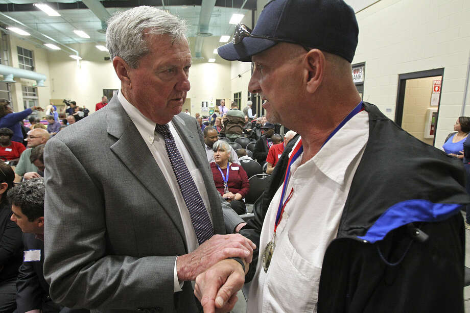 Haven for Hope founder Bill Greehey (left) talks with graduate Ralph Wooster during a ceremony to mark the campus getting 1,000 people into permanent housing. Photo: Photos By Tom Reel / San Antonio Express-News