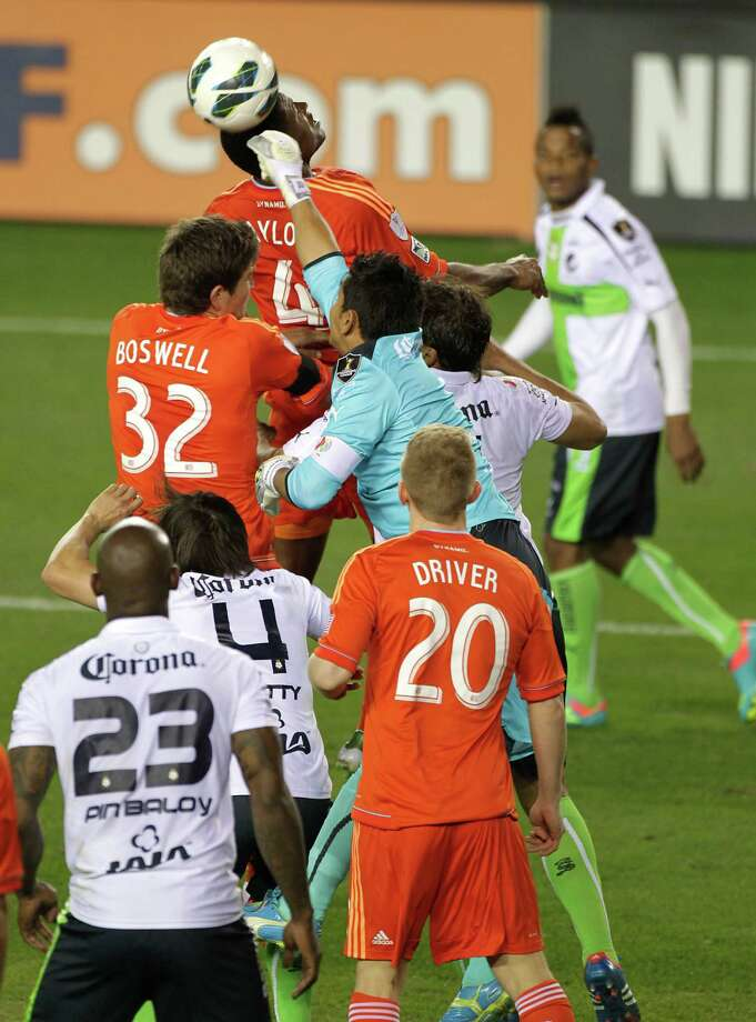 Santos Laguna's goal keeper Oswaldo Sanchez center right, blocks a Houston Dynamo shot during the second half of the CONCACAF Champions League quarterfinal series game at BBVA Compass Stadium Tuesday, March 5, 2013, in Houston. Photo: James Nielsen, Houston Chronicle / © 2013  Houston Chronicle