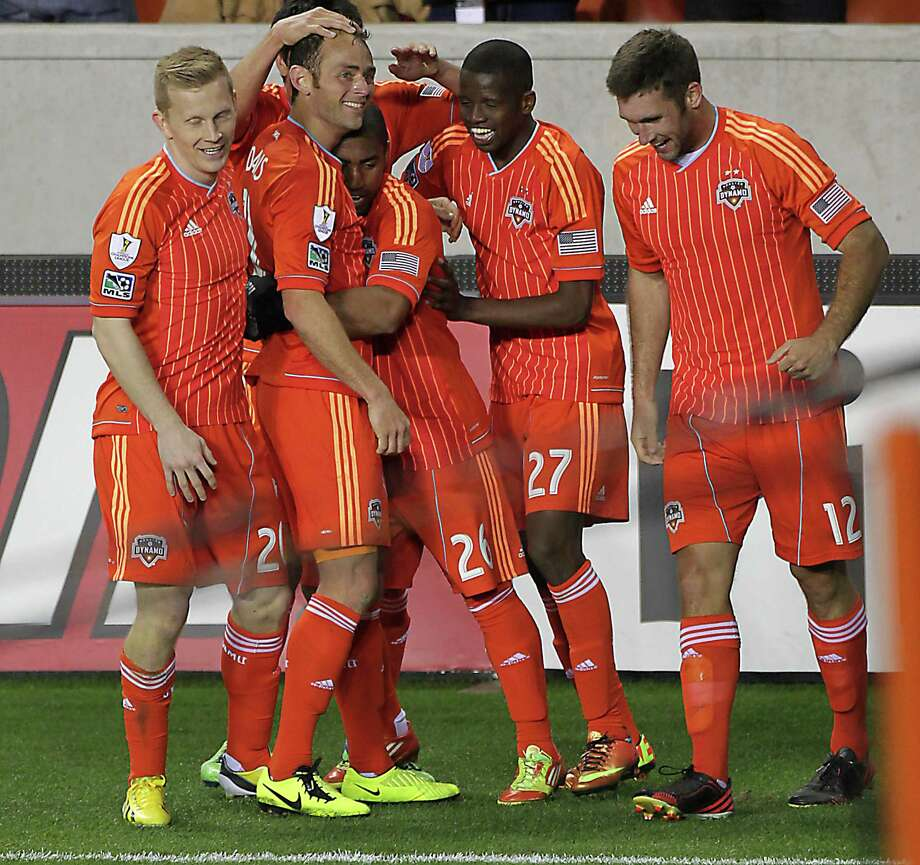 The Houston Dynamo's Brad Davis 2nd from left, celebrates with teammates after scoring a goal against Santos Laguna during the second half of the CONCACAF Champions League quarterfinal series game at BBVA Compass Stadium Tuesday, March 5, 2013, in Houston. Photo: James Nielsen, Houston Chronicle / © 2013  Houston Chronicle