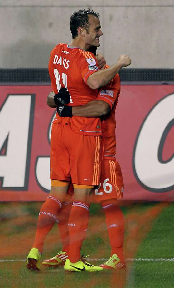 The Houston Dynamo's Brad Davis left, celebrates with teammate Corey Ashe right after scoring a goal against Santos Laguna during the second half of the CONCACAF Champions League quarterfinal series game at BBVA Compass Stadium Tuesday, March 5, 2013, in Houston. Photo: James Nielsen, Houston Chronicle / © 2013  Houston Chronicle